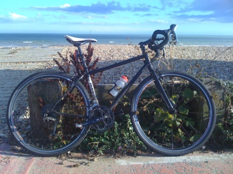 My Commuting Steed. Taken on NCN2 Lancing Beach, West Sussex (next to yet another 'Cyclists Dismount' sign)